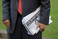 UK. London. The Village Green: From Blair to Brexit.<br /> A story on the relationship between the Media, Politicians and the public as they come together on College Green, a small patch of land next to The Houses of Parliament in Westminster.<br /> Photo shows a journalist holding a copy of a newspaper with 'The Blair Years' as a headline, after Tony Blair resigned as Prime Minister.<br /> Photo&copy;Steve Forrest/Workers' Photos