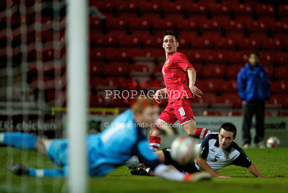 WREXHAM, WALES - Wednesday, February 9, 2011: Wales' Elliott Chamberlain sees his shot go wide of the Northern Ireland goal during the Under-21 International Friendly match at the Racecourse Ground. (Photo by David Rawcliffe/Propaganda)
