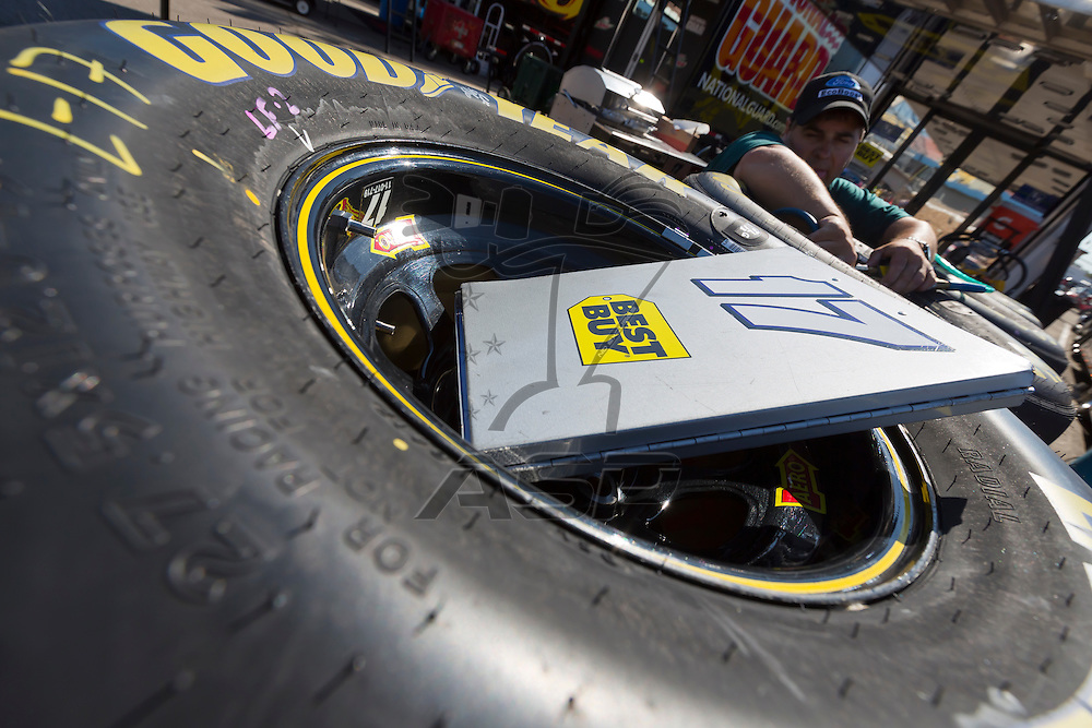 BROOKLYN, MI - JUN 14, 2012:  The Best Buy crew work during a test session for the Quicken Loans 400 at the Michigan International Speedway in Brooklyn, MI.