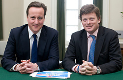 Leader of the Conservative Party David Cameron with  Richard Benyon, Member of Parliament for Newbury in his office in Norman Shaw South, January 18, 2010. Photo By Andrew Parsons / i-Images.