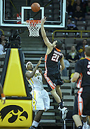December 04 2010: Idaho State Bengals forward/center Abner Moreira (21) puts up a shot over Iowa Hawkeyes forward Melsahn Basabe (1) during the first half of their NCAA basketball game at Carver-Hawkeye Arena in Iowa City, Iowa on December 4, 2010. Iowa won 70-53.