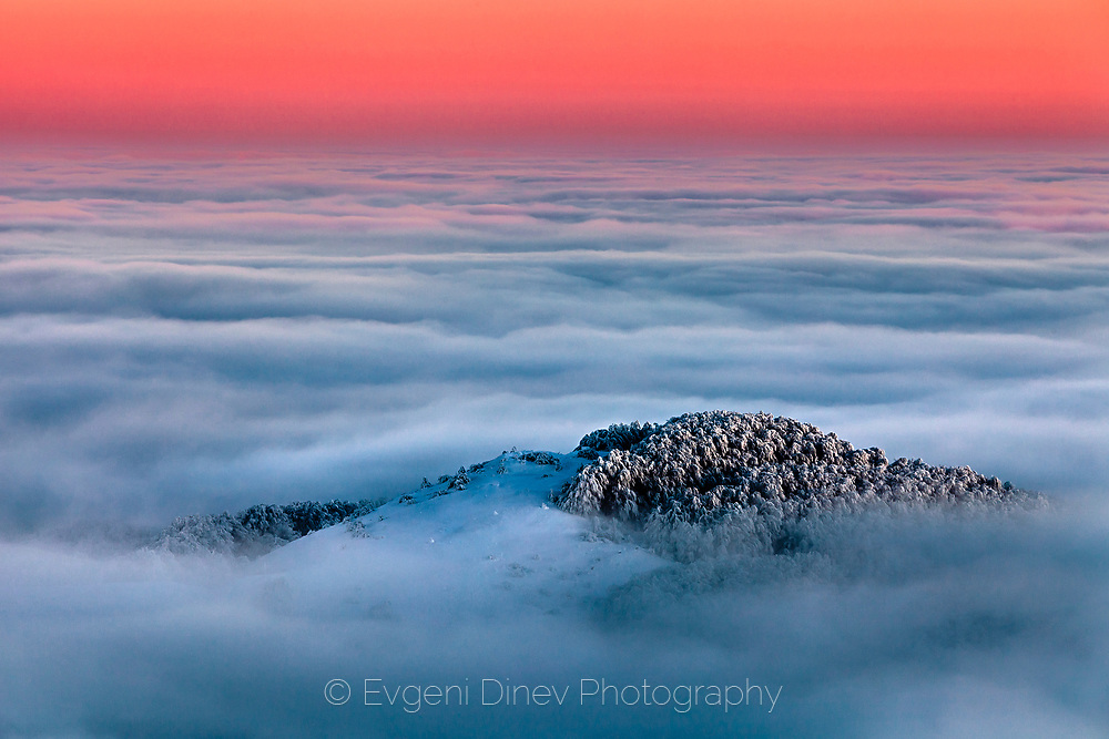 A part of mountain ridge above the clouds