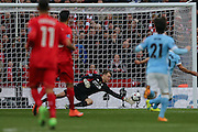 Liverpool goalkeeper Simon Mignolet (22) saves during the Capital One Cup match between Liverpool and Manchester City at Anfield, Liverpool, England on 28 February 2016. Photo by Simon Davies.