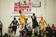Catamounts forward Hector Harold (5) leaps for a lay up during the men's basketball game between the Binghamton Bearcats and the Vermont Catamounts at Patrick Gym on Monday night January 19, 2015 in Burlington, Vermont. (BRIAN JENKINS, for the Free Press)