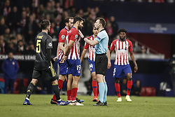February 20, 2019 - Madrid, Spain - The referee requests the revision of a move via VAR UCL Champions League match between Atletico de Madrid vs Juventus at the Wanda Metropolitano stadium in Madrid, Spain, February 20, 2019  (Credit Image: © Enrique De La Fuente/NurPhoto via ZUMA Press)