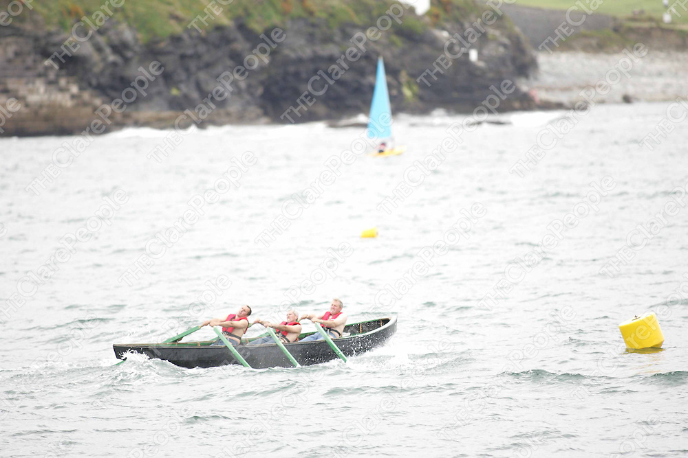 The Carrigaholt team lead the first currach race(the Ian Benson and JJ Harrington Memorial Cup) in Kilkee on Sunday. Pic. Brian Arthur/ Press 22.
