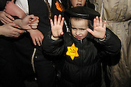 """An Ultra-Orthodox Jewish kid wearing a yellow path written """"JUDE""""  in a demonstrated this evening at Kikar Hashabat of Me'ah She'arim in the city of Jerusalem as part of rally Against media attack against the ultra-Orthodox public. Dec 31, 2011. Photo by Oren Nahshon."""