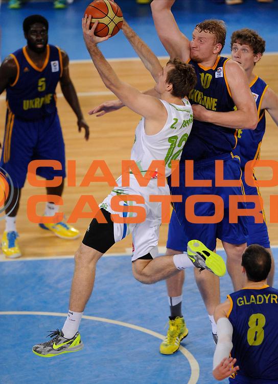 DESCRIZIONE : Lubiana Ljubliana Slovenia Eurobasket Men 2013 Finale Quinto Sesto Posto Slovenia Ucraina Final for 5th to 6th place Slovenja Ukraine<br /> GIOCATORE : Zoran Dragic<br /> CATEGORIA : tiro shot<br /> SQUADRA : Slovenia Slovenja<br /> EVENTO : Eurobasket Men 2013<br /> GARA : Slovenia Ucraina Slovenja Ukraine<br /> DATA : 21/09/2013 <br /> SPORT : Pallacanestro <br /> AUTORE : Agenzia Ciamillo-Castoria/N.Parausic<br /> Galleria : Eurobasket Men 2013<br /> Fotonotizia : Lubiana Ljubliana Slovenia Eurobasket Men 2013 Finale Quinto Sesto Posto Slovenia Ucraina Final for 5th to 6th place Slovenja Ukraine<br /> Predefinita :