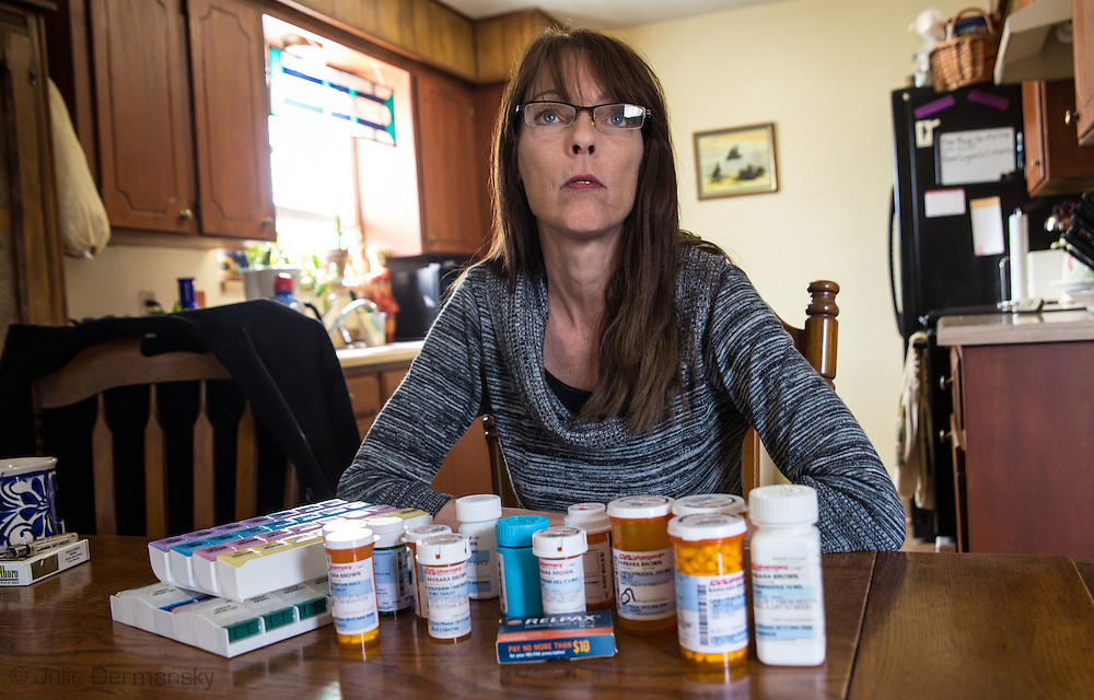 Barbara Brown with drugs she takes for health issues she developed after the fracking industry developed near her home n Reno Texas. She lives less the 1/4 mile from a d fracking site, and a wastewater disposal site. Her home has been damaged be an earthquake swarm that started rattling the ground in November 2013 shortly aft re the disposal plant began operation.Her doctors told her all the toxins have made her ill.