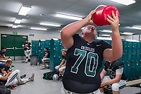 Granite Bay Grizzly's Zachary Gillies (70), drinks water inside the locker room before the game as the Granite Bay Grizzly's varsity football team host the Folsom Bulldog's at Granite Bay High School, Friday Sep 29, 2017.<br /> photo by Brian Baer