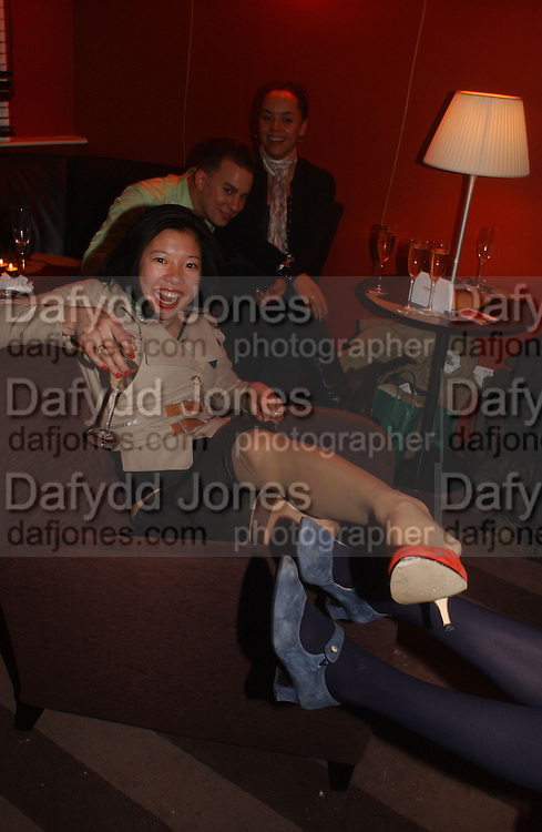 Shirley Sum and Iris Palmer wearing Cynnie Rainey shoes, DAZED AND CONFUSED GAP RED PARTY, Groucho Club, Dean st. London. 15 March 2006. ONE TIME USE ONLY - DO NOT ARCHIVE  © Copyright Photograph by Dafydd Jones 66 Stockwell Park Rd. London SW9 0DA Tel 020 7733 0108 www.dafjones.com