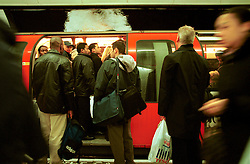 UK ENGLAND LONDON 13MAR02 - Overcrowded Central Line train at Bank Station. ..The London Underground is a rapid transit system serving a large part of Greater London and neighbouring areas of Essex, Hertfordshire and Buckinghamshire in the UK. The Underground has 270 stations and about 400 km of track, making it the longest metro system in the world by route length; it also has one of the highest number of stations and transports over three million passengers daily...jre/Photo by Jiri Rezac..© Jiri Rezac 2002