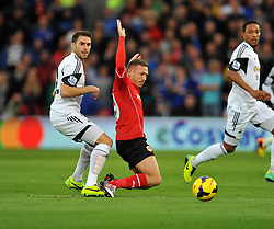 Swansea City's Angel Rangel fouls Cardiff City's Craig Bellamy - Photo mandatory by-line: Alex James/JMP - Tel: Mobile: 07966 386802 03/11/2013 - SPORT - FOOTBALL - The Cardiff City Stadium - Cardiff - Cardiff City v Swansea City - Barclays Premier League