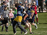 A member of Penn State grabs the Snitch during the Quidditch World Cup on April 5, 2014 in Myrtle Beach, South Carolina. The sport, created from the Harry Potter novels is a co-ed contact sport with elements from rugby, basketball, and dodgeball. A quidditch team is made up of seven athletes who play with broomsticks between their legs at all times.