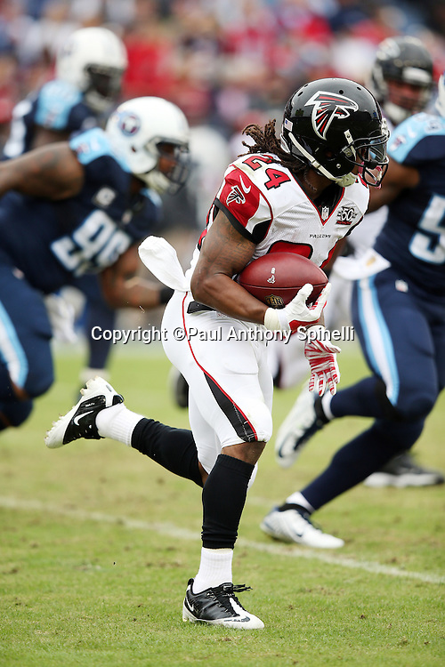 Atlanta Falcons running back Devonta Freeman (24) runs for a first quarter first down during the 2015 week 7 regular season NFL football game against the Tennessee Titans on Sunday, Oct. 25, 2015 in Nashville, Tenn. The Falcons won the game 10-7. (©Paul Anthony Spinelli)