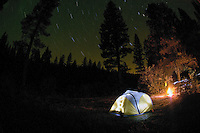 Illuminated Tent  and Campfire under a Night Sky<br /> <br /> Shot in Oregon, USA