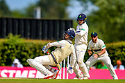 Steven Finn of Middlesex avoids a bouncer from Markus Labuschagne of Glamorgan during the Specsavers County Champ Div 2 match between Middlesex County Cricket Club and Glamorgan County Cricket Club at Radlett Cricket Ground, Radlett, Herfordshire,United Kingdom on 17 June 2019.