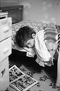 Neville in bed reading comic, 16 Hawthorne Rd,High Wycombe. UK, 1980s.