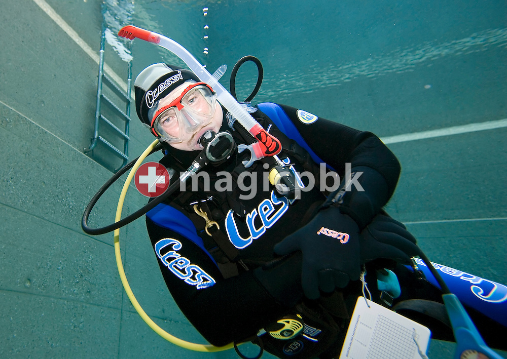 Diving instructor Erich Jung is pictured during a PADI scuba diving training lesson in the outdoor pool in Gossau, ZH, Switzerland, Monday, May 26, 2008. (Photo by Patrick B. Kraemer / MAGICPBK)