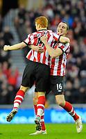 20111226: LONDON, UK - Barclays Premier League 2011/2012: Sunderland vs Everton.<br /> In photo: Jack Colback of Sunderland AFC (L) celebrates scoring his side's first goal with team mates.<br /> PHOTO: CITYFILES