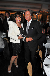 JOAN COLLINS and RICHARD CARING at a dinner to celebrate the 30th anniversary of Le Caprice, Arlington Street, London SW1 on 4th October 2011.