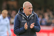 Queens Park Rangers City manager Mark Warburton applauds the Brentford fans, supporters, before the EFL Sky Bet Championship match between Brentford and Queens Park Rangers at Griffin Park, London, England on 11 January 2020.