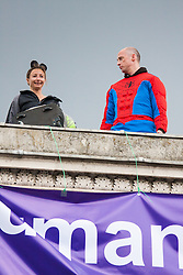 London, August 12th 2014. A woman protests against unfair custody and visitation rights alongside men from Fathers For Justice, atop Decimus Burton's Ionic screen entrance to Hyde Park adjacent to Apsley House at  Hyde Park Corner.