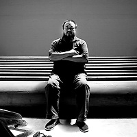 "BEIJING, MAY- 18 : Chinese artist Ai Weiwei, 50,  poses in his studio days before he leaves for the Documenta art exhibition in Germany . Ai will bring 1001 of his compatriots to Germany to spend months wandering around the city of Kassel as live exhibits for his entry to a leading modern art show...His "" Fairytale""  artwork would cost  EU 3,1-million, the most expensive project of 2007's Documenta exhibition."