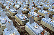 February 2005 - Quang Tri, Vietnam - Identical graves at the Trung Son Cemetery dedicated to soldiers who lost their lives on the Ho Chi Minh Trail in Vietnam. Photo Credit: Luke Duggleby