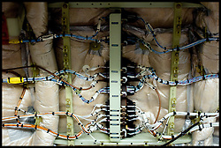Wires on show inside the A340 as the plane is dismantled at Air Salvage International in Cirencester, Cotswold,United Kingdom, Friday, 15th November 2013. The Planes at the Aeroplane Scrapyard are taken apart for spare parts and scrap. In the air, A plane could be worth around £12.5M, But as parts it might be worth almost £19M. Almost everything on a modern airliner can be recycled, except the light bulbs and tyres. More than 40 planes are recycled at Air Salvage a year. Picture by Andrew Parsons / i-Images