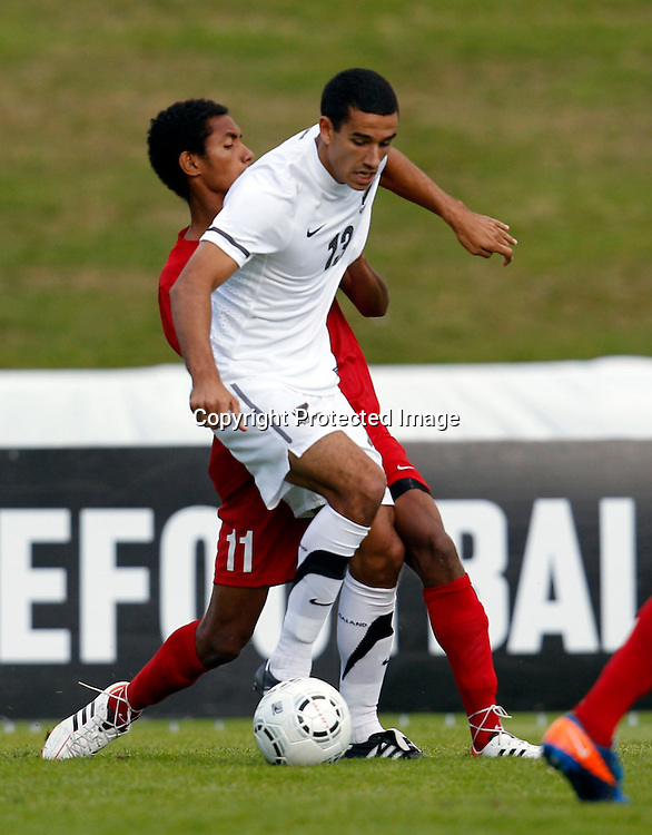 NZ's Alex Feneridis goes up against PNG's Vanya Malagian. OFC Men's Olympic Qualifier New Zealand 2012, New Zealand v Papua New Guinea, Owen Delany Park Taupo, Friday 16th March 2012. Photo: Shane Wenzlick
