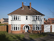 Large detached inter-war house with bay windows, Claydon, Suffolk, England
