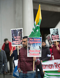Campaigners marched down the Royal Mile in Edinburgh waving placards, banners and Kashmir flags to highlight calls for independence for the disputed region of Kashmir. They then held a rally outside the Scottish Parliament.<br /> <br /> © Dave Johnston/ EEm