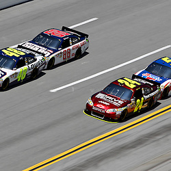 April 17, 2011; Talladega, AL, USA; NASCAR Sprint Cup Series drivers Dale Earnhardt Jr. (88) bump drafts with Jimmie Johnson (48) and Mark Martin (5) bump drafts with Jeff Gordon (24) during the Aarons 499 at Talladega Superspeedway.   Mandatory Credit: Derick E. Hingle