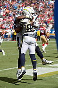 Los Angeles Chargers tight end Antonio Gates (85) celebrates with Los Angeles Chargers center Mike Pouncey (53) after Gates catches a 5 yard touchdown pass that cuts the San Francisco 49ers first quarter lead to 14-6 during the NFL week 4 regular season football game against the San Francisco 49ers on Sunday, Sept. 30, 2018 in Carson, Calif. The Chargers won the game 29-27. (©Paul Anthony Spinelli)