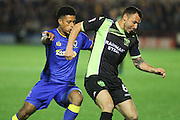 AFC Wimbledon striker Lyle Taylor and Bury FC midfielder Antony Kay during the The Emirates FA Cup 1st Round Replay match between AFC Wimbledon and Bury at the Cherry Red Records Stadium, Kingston, England on 15 November 2016. Photo by Stuart Butcher.