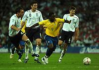 Photo: Tony Oudot.<br /> England v Brazil. International Friendly. 01/06/2007.<br /> Vagner Love of Brazil takes on the England defence
