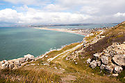 Chiswell village at the start of Chesil Beach with Weymouth harbour beyond, Isle of Portland, Dorset, England