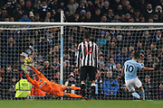 Karl Darrow almost gets the ball from Sergio Aguero's penalty during the Premier League match between Manchester City and Newcastle United at the Etihad Stadium, Manchester, England on 20 January 2018. Photo by George Franks.
