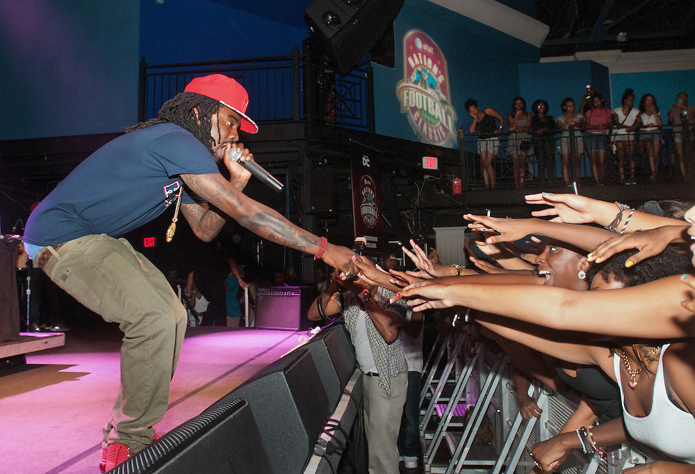 Rap star Wale reaches out to his fans during a performance at the AT&T Kickoff Rally at the 9:30 Club in Washington, DC Friday night.  (photo by Alan Lessig)