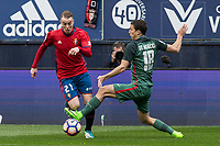 Carlos Clerc of Club Atletico Osasuna competes for the ball with De Marcos of Athletic Club during the match of  La Liga between Club Atletico Osasuna and Athletic Club Bilbao at El Sadar Stadium  in Pamplona, Spain. April 01, 2017. (ALTERPHOTOS / Rodrigo Jimenez)