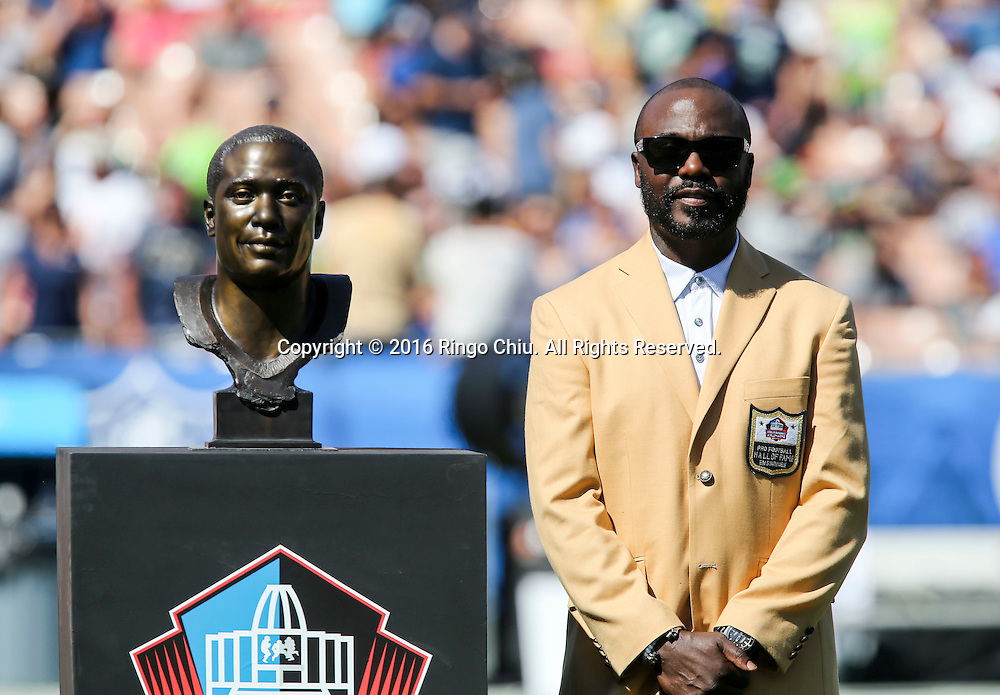 Former Rams team member Marshall Faulk stands with his bust during the Rams Hall of Fame Ring of Excellence ceremony at halftime of an NFL football game between the Rams and the Seattle Seahawks at the Los Angeles Memorial Coliseum, Sunday, Sept. 18, 2016, in Los Angeles.(Photo by Ringo Chiu/PHOTOFORMULA.com)<br /> <br /> Usage Notes: This content is intended for editorial use only. For other uses, additional clearances may be required.