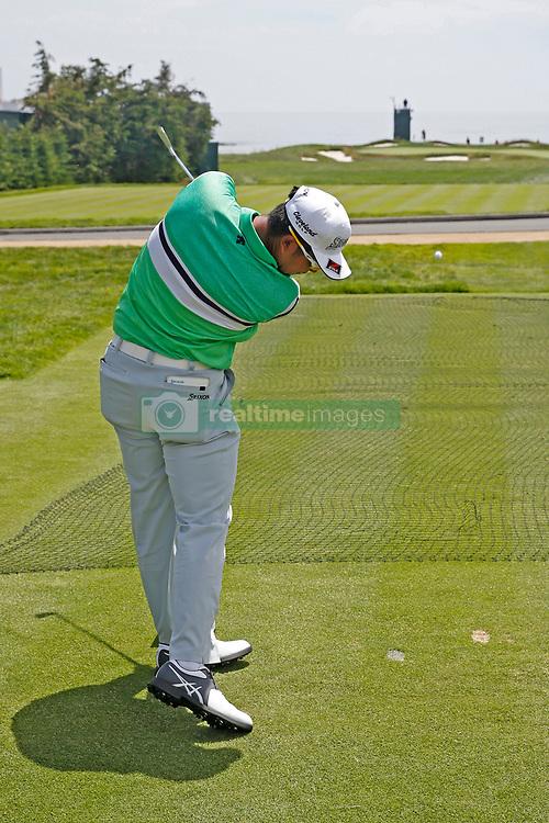 June 11, 2019 - Pebble Beach, CA, U.S. - PEBBLE BEACH, CA - JUNE 11: PGA golfer Hideki Matsuyama tees off on the 17th hole during a practice round for the 2019 US Open on June 11, 2019, at Pebble Beach Golf Links in Pebble Beach, CA. (Photo by Brian Spurlock/Icon Sportswire) (Credit Image: © Brian Spurlock/Icon SMI via ZUMA Press)