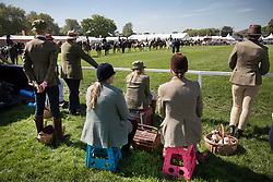 © Licensed to London News Pictures. 10/05/2017. Windsor, UK. Riders take a break to watch competitors in the Senior Horse/Pony - ridden category on the first day of the Royal Windsor Horse Show. The five day equestrian event takes place in the grounds of Windsor Castle. Photo credit: Peter Macdiarmid/LNP