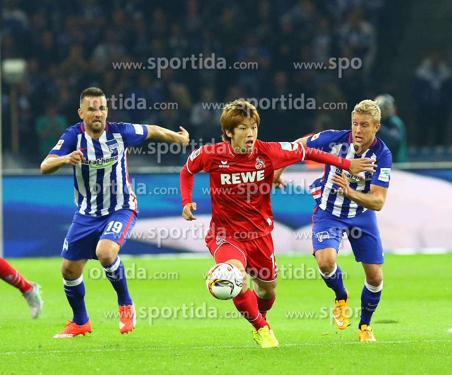 22.09.2015, Olympiastadion, Berlin, GER, 1. FBL, Hertha BSC vs 1. FC Koeln, 6. Runde, im Bild Yuya Osako (#13, 1. FC Koeln) setzt sich gegen Vedad Ibisevic (#19, Hertha BSC Berlin) und Per Ciljan Skjelbred (#3, Hertha BSC Berlin) durch // during the German Bundesliga 6th round match between Hertha BSC and 1. FC Cologne at the Olympiastadion in Berlin, Germany on 2015/09/22. EXPA Pictures &copy; 2015, PhotoCredit: EXPA/ Eibner-Pressefoto/ Hundt<br /> <br /> *****ATTENTION - OUT of GER*****