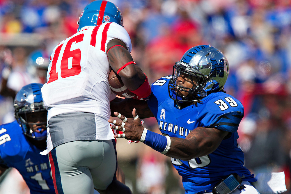 MEMPHIS, TN - OCTOBER 17:  Reggis Ball #39 of the Memphis Tigers tackles Collins Moore #16 of the Ole Miss Rebels at Liberty Bowl Memorial Stadium on October 17, 2015 in Memphis, Tennessee.  The Tigers defeated the Rebels 37-24.  (Photo by Wesley Hitt/Getty Images) *** Local Caption ***  Reggis Ball; Collins Moore