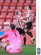 Dan Holman scores his second goal and celebrates during the Vanarama National League match between Cheltenham Town and Bromley at Whaddon Road, Cheltenham, England on 30 January 2016. Photo by Antony Thompson.