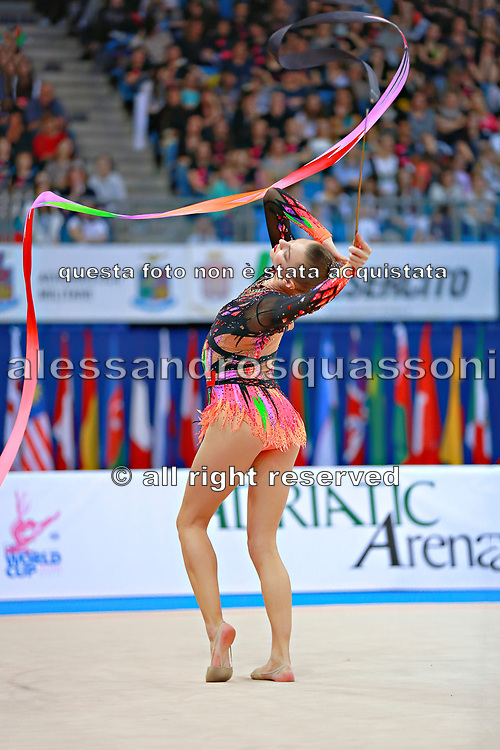 Staniouta Melitina during final at ribbon in Pesaro World Cup 03 April 2016. Melitina is an Belarusian rhythmic gymnast, she was born in 15 November 1993 Minsk. She is a three time World All-around bronze medalist in 2015,2013,2010 retired from rhythmic gymnastics in December 2016.