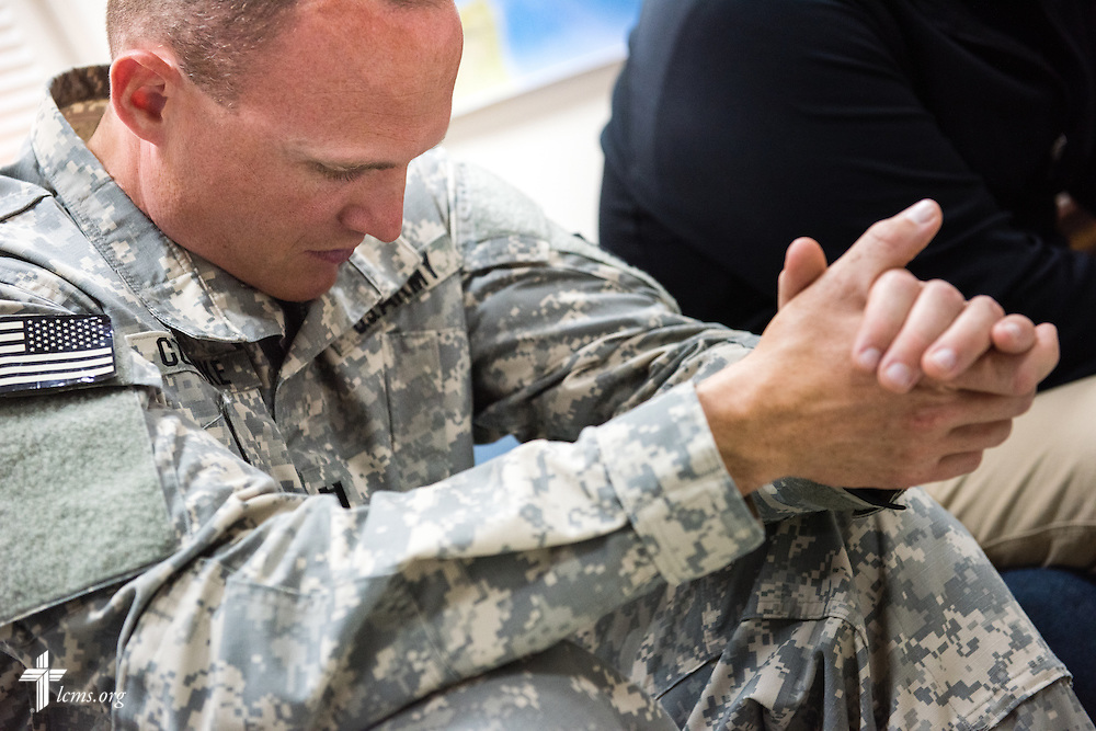 Army Capt. Chad Czischke, chaplain, prays Sunday, March 22, 2015, at Camp Buehring in Kuwait. LCMS Communications/Erik M. Lunsford