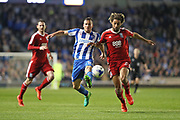 Brighton & Hove Albion centre forward Tomer Hemed (10) and Birmingham City defender Ryan Shotton (5) compete during the EFL Sky Bet Championship match between Brighton and Hove Albion and Birmingham City at the American Express Community Stadium, Brighton and Hove, England on 4 April 2017.